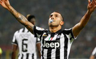 Tévez anotó en el Milan-Juventus y celebró con un chupón