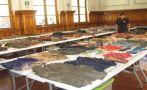 Prendas halladas en fosas de Los Cabitos se exhiben en Ica