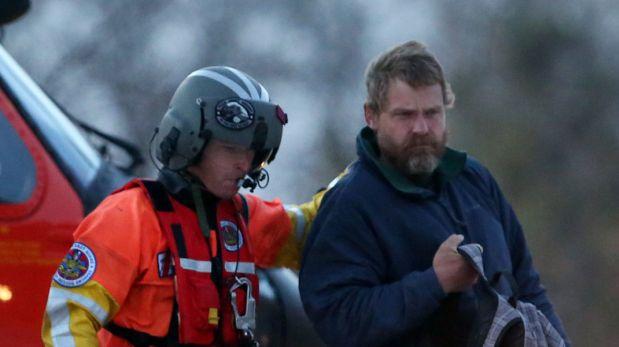 Louis Jordan (derecha), sobreviviente estadounidense. (AP)