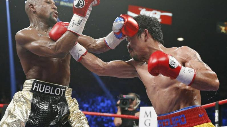 Floyd Mayweather vs Manny Pacquiao.   (Foto: AFP)