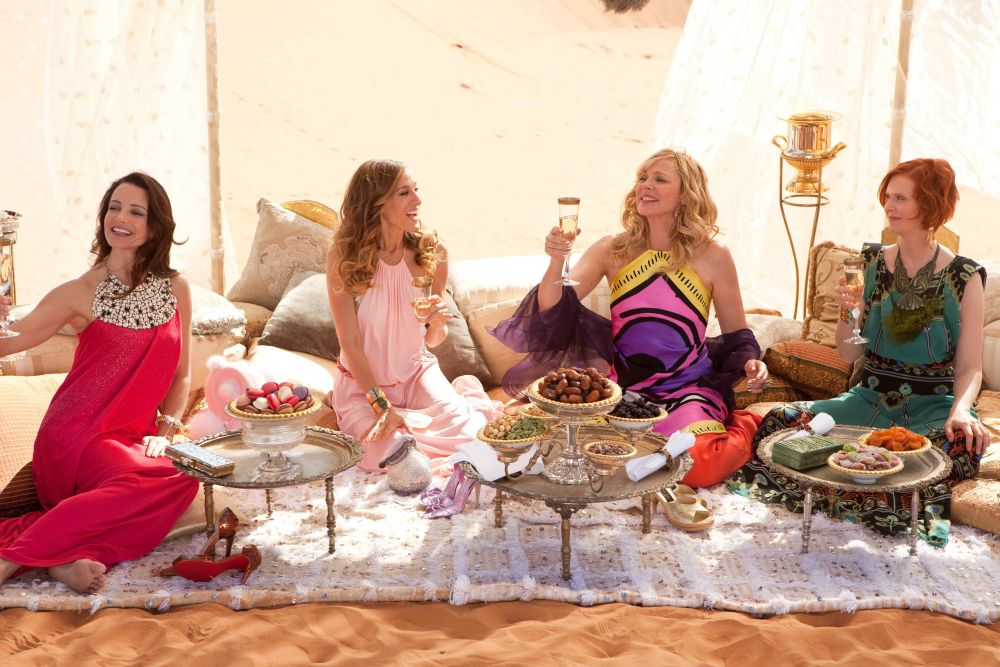 In this film publicity image released by Warner Bros., from left, Kristin Davis, Sarah Jessica Parker, Kim Cattrall and Cynthia Nixon are shown in a scene from