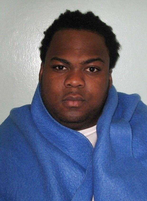 An undated handout picture released by the British Metropolitan Police Service (MPS) on June 23, 2015 shows the custody photograph of Nicholas Salvador after his arrest in London. A 25-year-old paranoid schizophrenic who beheaded an elderly woman during a 45-minute rampage through London back gardens was on Tuesday found not guilty of murder by reason of insanity and locked up indefinitely. RESTRICTED TO EDITORIAL USE - MANDATORY CREDIT