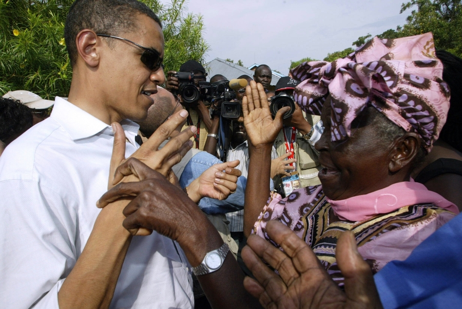 (FILES) In this August 26, 2006 file photo US senator of Kenyan descent, Barrack Obama greets his grandmother Sarah Obama at their rural home in Siaya, Kisumu, 365km western of the capital, during his first visit in 14 years. US President Barack Obama will make a long-awaited trip to Kenya later this year, visiting his father's homeland for the first time since becoming US president six years ago, the White House said March 30, 2015. During the long-promised visit this July, Obama will attend a Global Entrepreneurship Summit in the east African nation, a statement said.    AFP PHOTO / SIMON MAINA / FILES