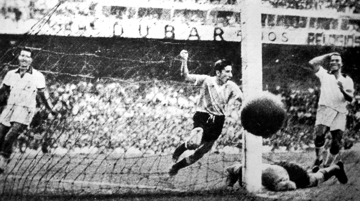 ** FILE ** Uruguay player Alcides Ghiggia scores during the World Cup Final, against Brazil, in the Maracana Stadium in Rio de Janeiro, Brazil, July 16, 1950 . Uruguay defeated  Brazil 2-1 to win the 1950 World Cup. (AP Photo)