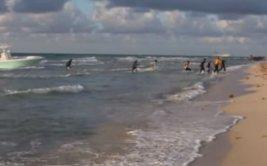 Inmigrantes ilegales desembarcan en grabación de modelo [VIDEO]