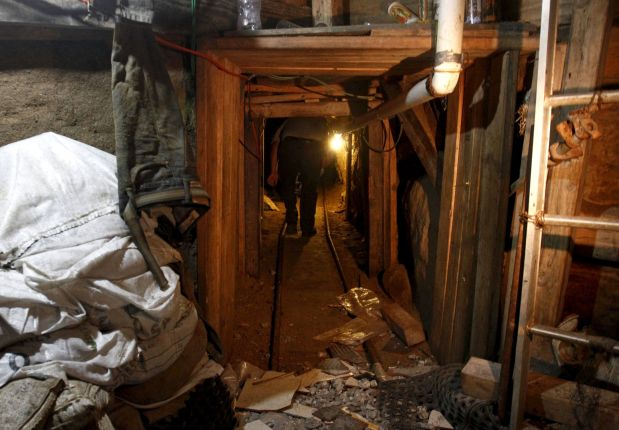 A journalist walks through a tunnel discovered by the Mexican Army, during a presentation to the media in Tijuana, Mexico August 2, 2015. According to local media, authorities found the tunnel, which is still under construction at the northern city of Tijuana which borders with the United States. REUTERS/Jorge Duenes