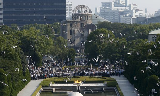 Doves fly over the Peace Memorial Park with the Atomic Bomb Dome in the background, at a ceremony in Hiroshima, western Japan, August 6, 2015, on the 70th anniversary of the atomic bombing of the city. Japan on Thursday marked the 70th anniversary of the attack on Hiroshima, where the U.S. dropped an atomic bomb on August 6, 1945, killing about 140,000 by the end of the year in a city of 350,000 residents. It was the world's first nuclear attack. The Atomic Bomb Dome, or Genbaku Dome, was the only structure left standing in this district of the city and has been preserved as a peace memorial.   REUTERS/Toru Hanai