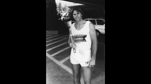 FILE - In this 1984 file photo provided by Heritage Auctions, American Decathlete, Bruce Jenner poses with the 1984 Olympic Torch he carried through Lake Tahoe, Nevada. The 24-inch torch, featuring a brass finish and wood handle, is being offered by Heritage Auctions on July 30, 2015 at its Platinum Night Sports Auction in Chicago. It is the first significant piece of Jenner memorabilia to go to auction since the winner of the 1976 Olympic Decathlon Gold Medal became Caitlyn Jenner. (Heritage Auctions via AP)