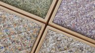 Billetes triturados se convierten en tapiz