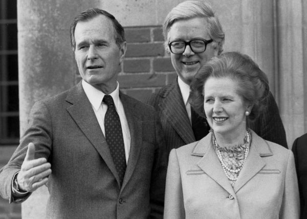 FILE - In this Feb. 12, 1984 file photo, US vice President George Bush, left, poses for a photograph with British Prime Minister Margaret Thatcher, right, and British Foreign Secretary Geoffrey Howe, in London. The family of Britain's former Treasury chief Geoffrey Howe says the longtime Conservative Party figure has died at his home. He was 88. The family said Saturday that he had died suddenly of a suspected heart attack late Friday night, Oct. 9, 2015,  at his home in Warwickshire, north of London. (PA via AP, File) UNITED KINGDOM OUT NO SALES NO ARCHIVE