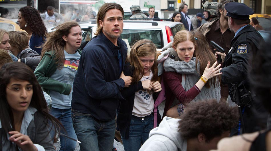 This publicity image released by Paramount Pictures shows, from center left, Brad Pitt as Gerry Lane, Abigail Hargrove as Rachel Lane, and Mireille Enos as Karin Lanein a scene from