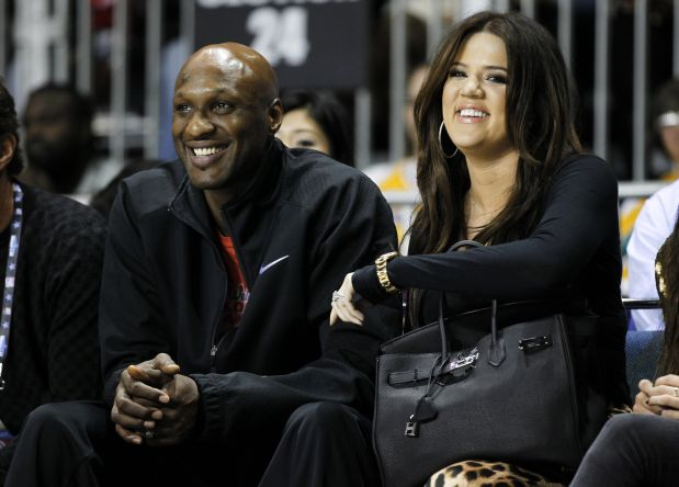 Los Angeles Lakers' Lamar Odom and his wife television personality Khloe Kardashian sit courtside as they attend the 2011 BBVA All-Star Celebrity basketball game as a part of the NBA All-Star basketball weekend in Los Angeles, in this February 18, 2011, file photo. Odom was hospitalized on October 13, 2015, after he was found unresponsive at a Nevada brothel, law enforcement officials said. REUTERS/Danny Moloshok/Files