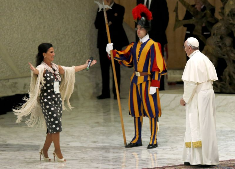 Pope Francis (R) is greeted by singer Maria Jose Santiago after her performance at a special audience with Roman Sinti community led by the pope at the Paul VI hall at the Vatican, October 26, 2015. REUTERS/Alessandro Bianchi