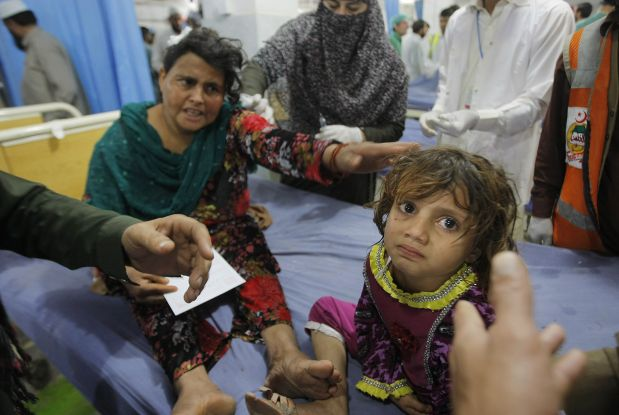 A Pakistani mother waits for treatment with her daughter at a local hospital in Peshawar, Pakistan, Monday, Oct. 26, 2015. A powerful 7.7-magnitude earthquake in northern Afghanistan rocked cities across South Asia. Strong tremors were felt in Kabul, New Delhi and Islamabad on Monday. In the Pakistani capital, walls swayed back and forth and people poured out of office buildings in a panic, reciting verses from the Quran. (AP Photo/Mohammad Sajjad)