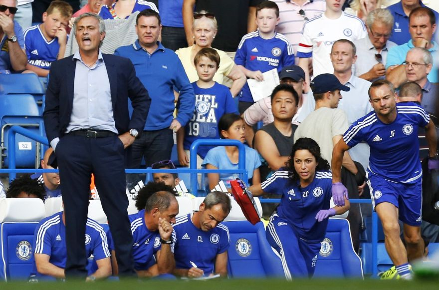 (FILES) In a file picture taken on August 8, 2015 Chelsea doctor (2R) Eva Carneiro and head physio Jon Fearn (R) leave the bench to treat Chelsea's Belgian midfielder Eden Hazard late in the game as Chelsea's Portuguese manager Jose Mourinho (L) gestures during the English Premier League football match between Chelsea and Swansea City  at Stamford Bridge in London. Chelsea manager Jose Mourinho has been sacked after a disastrous start to the Premier League season on December 17, 2015.AFP PHOTO / IAN KINGTONRESTRICTED TO EDITORIAL USE. No use with unauthorized audio, video, data, fixture lists, club/league logos or 'live' services. Online in-match use limited to 75 images, no video emulation. No use in betting, games or single club/league/player publications.
