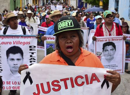 Relatives and friends of the 43 missing students from Ayotzinapa take part in a demonstration in Iguala, Guerrero State, Mexico, on September 27, 2015, to commemorate the first anniversary of their disappearance. The students, from a rural teachers school in the southern state of Guerrero, disappeared after they were attacked by local police in the city of Iguala on September 26, 2014. AFP PHOTO/RONALDO SCHEMIDT