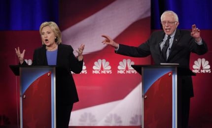 Democratic U.S. presidential candidate and former Secretary of State Hillary Clinton and rival candidate U.S. Senator Bernie Sanders speak simultaneously at the NBC News - YouTube Democratic presidential candidates debate in Charleston, South Carolina January 17, 2016. REUTERS/Randall Hill (TPX IMAGES OF THE DAY)