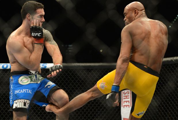 Dec 28, 2013; Las Vegas, NV, USA;    Anderson Silva (blue gloves) breaks his leg on a kick to Chris Weidman (red gloves) during their UFC middleweight championship bout at the MGM Grand Garden Arena. Mandatory Credit: Jayne Kamin-Oncea-USA TODAY Sports