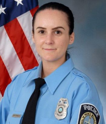This undated photo provided by the Prince William County Police shows Officer Ashley Guindon. Ronald Williams Hamilton is being held without bond in the Prince William County Adult Detention Center on charges that include murder of a law enforcement officer, Guindon. (Prince William County Police via AP)
