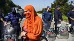 El día en fotos: Alain Decaux, refugiados, simulacro y más - Noticias de simulacro