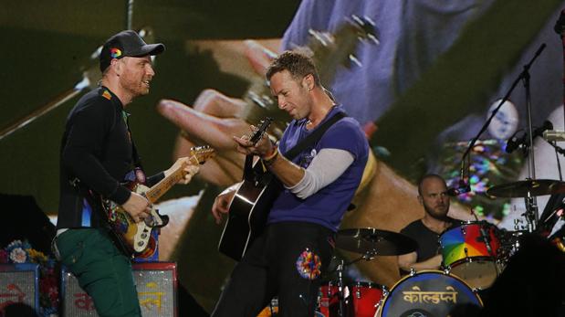 Jon Buckland, Chris Martin y Will Champion de Coldplay. (Foto: Dante Piaggio/ El Comercio)