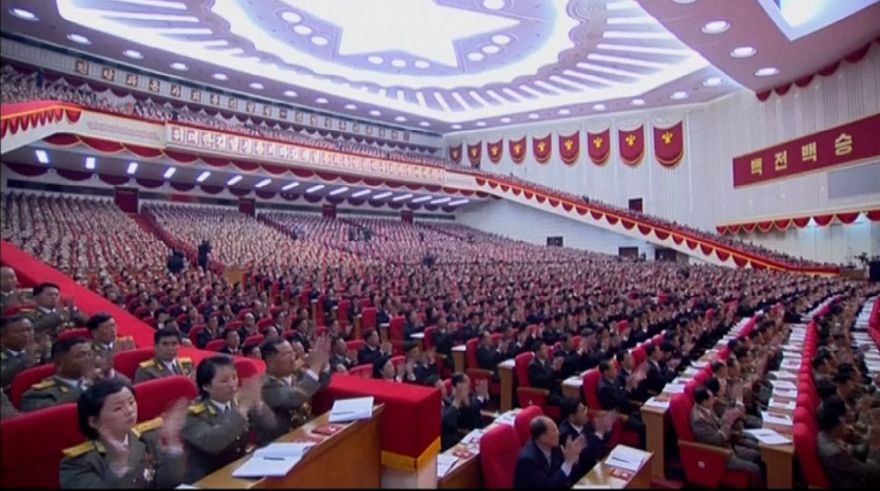 In this image made from video by North Korean broadcaster KRT, military officers and delagates applaud as North Korean leader Kim Jong Un gives speech at the party congress in Pyongyang, North Korea, Saturday, May 7, 2016. North Korea will not use its nuclear weapons first unless its sovereignty is invaded, state media on Sunday, May 8, quoted Kim as saying during a critical ruling party congress. Kim also said he is ready to improve ties with