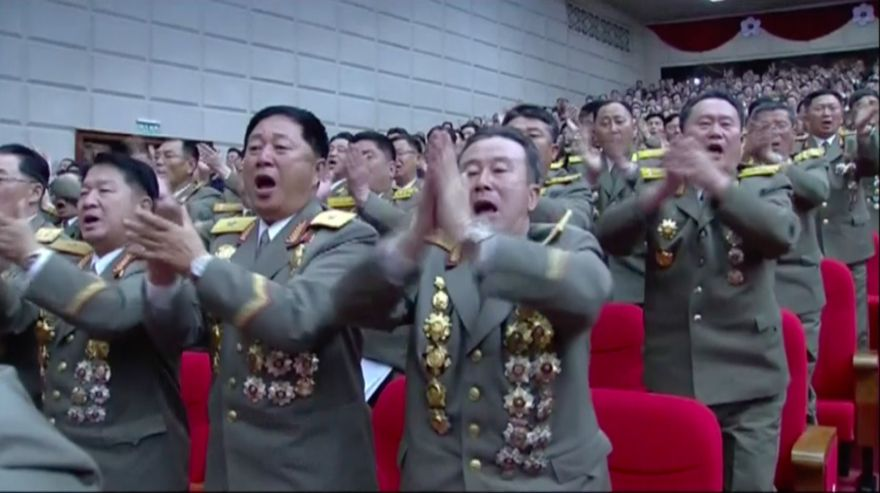 In this image made from video by North Korean broadcaster KRT, military officers applaud during the party congress in Pyongyang, North Korea, Saturday May 7, 2016. The state-run Korean Central News Agency said Saturday that the agenda for the congress included reviewing the works of the party's Central Committee and Central Audit Commission, revising party rules, electing leader Kim Jong Un to the top party post and electing a new central leadership for the party. (KRT via AP Video) NORTH KOREA OUT