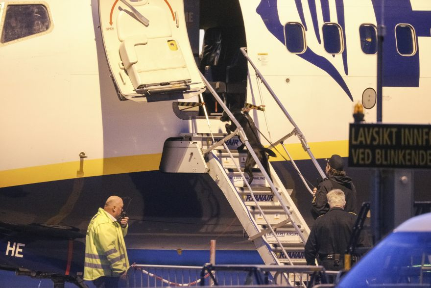 Police bomb squad search a Ryanair plane at Moss Airport Rygge, Norway, Sunday, May 15, 2016. Norwegian police say a Manchester-bound plane was evacuated before takeoff due to the ?suspicious behavior? of two passengers. (Haakon Mosvold Larsen / NTB via AP) NORWAY OUT
