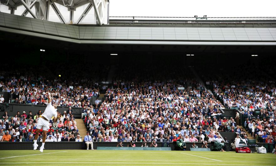 Switzerland's Roger Federer serves against Argentina's Guido Pella during their men's singles first round match on the first day of the 2016 Wimbledon Championships at The All England Lawn Tennis Club in Wimbledon, southwest London, on June 27, 2016. RESTRICTED TO EDITORIAL USE / AFP / ADRIAN DENNIS / RESTRICTED TO EDITORIAL USE