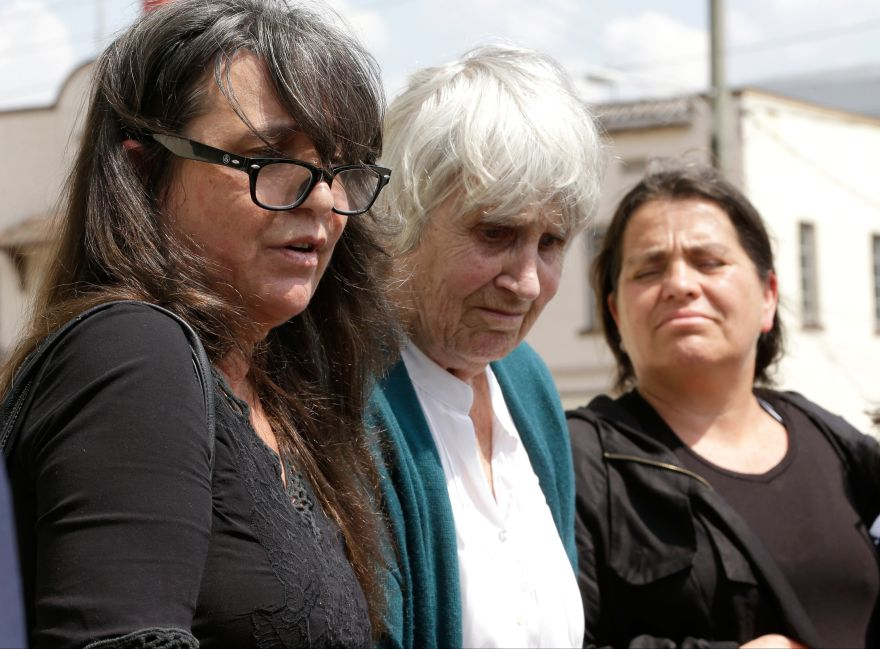 Joan Jara, center, wife of Chilean singer and songwriter Victor Jara, makes a statement with her daughters Manuela Bunster, left, and Amanda Jara Turner, right, at the federal courthouse, Monday, June 27, 2016, in Orlando, Fla., after a jury ruled that former Lt. Pedro Pablo Barrientos Nunez, a military officer in the regime of Chile's brutal dictator Augusto Pinochet, tortured and killed the folk singer more than 40 years ago and is awarding his family  million. (AP Photo/John Raoux)