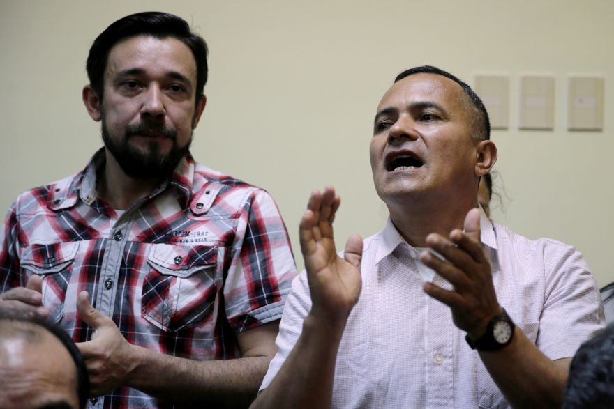 Paraguayan Ruben Villalba (R), suspected leader of a landless movement that clashed with police, gestures in court where he was sentenced to 30 years in prison for the
