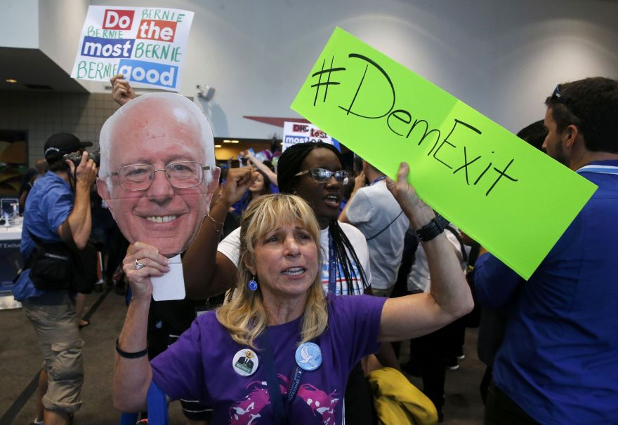 Supporters and delegates of former Democratic presidential candidate Senator Bernie Sanders walk out after Hillary Clinton was nominated during the second day at the Democratic National Convention in Philadelphia, Pennsylvania, U.S., July 26, 2016.   REUTERS/Jim Bourg