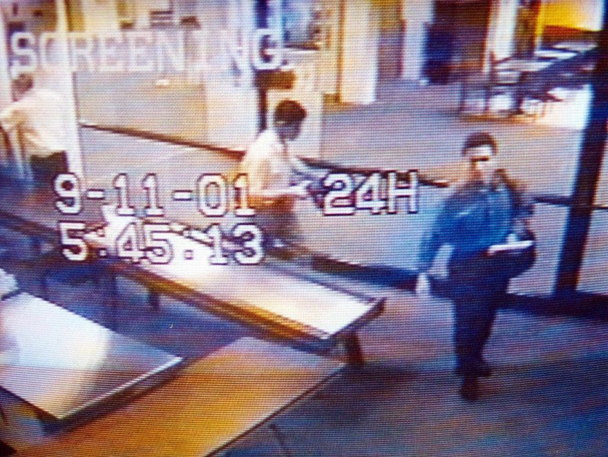 This video image from Portland International Jetport security released by the Portland, Maine, Police Department 19 September, 2001, reportedly shows suspected hijackers Mohammed Atta (R) and Abdulaziz Alomari (C) as they pass through airport security 11 September, 2001, at 5:45:13am. Authorities said the two men boarded a commuter flight to Boston before connecting to American Airlines Flight 11, one of four jetliners hijacked on 11 September and crashed into New York's World Trade Center.  AFP PHOTO/PORTLAND POLICE DEPARTMENT