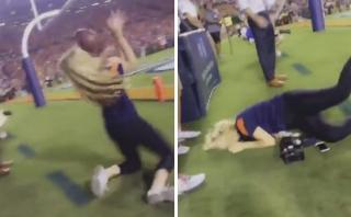Fotógrafa pasó vergüenza en estadio por querer atrapar un balón