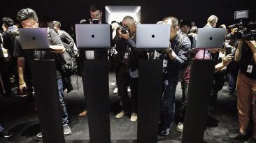 El día en fotos: Apple, Clinton, Italia, Venezuela y más