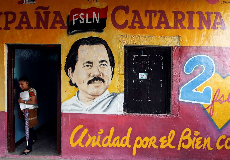 A woman walks past a mural of Nicaragua's President Daniel Ortega in Cataria town, Nicaragua October 28, 2016. Picture taken October 28, 2016.  REUTERS/Oswaldo Rivas          FOR EDITORIAL USE ONLY. NO RESALES. NO ARCHIVES.