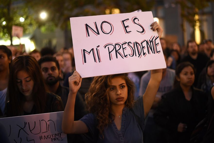 Kimmy, who declined to give a last name, rallies with protesters in Oakland, California, U.S. following the election of Donald Trump as President of the United States November 9, 2016. The sign reads: