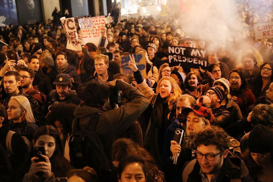 NEW YORK, NY - NOVEMBER 09: Thousands of anti-Trump protesters shut down 5th Avenue in front of Trump Tower as New Yorkers react to the election of Donald Trump as president of the United States on November 9, 2016 in New York City. Trump defeated Democrat Hillary Clinton in an upset to become the 45th president.   Spencer Platt/Getty Images/AFP== FOR NEWSPAPERS, INTERNET, TELCOS & TELEVISION USE ONLY ==