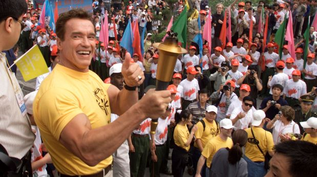 Actor Arnold Schwarzenegger gives a thumbs up during the official lighting of the Special Olympics torch on the Great Wall, north of Beijing, on Saturday May 20, 2000. Schwarzenegger climbed the Great Wall to light the torch to demonstrate his support for the Special Olympics China. Schwarzenegger is in the Chinese capital for several days to help promote the country's dedication to raising awareness about people with mental disabilities through the support of the Special Olympics. (AP Photo/Andrew Wong, Pool)
