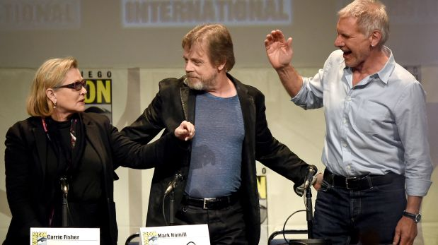 (FILES) This file photo taken on July 10, 2015 shows actors Carrie Fisher, Mark Hamill and Harrison Ford pose onstage at the Lucasfilm panel during Comic-Con International 2015 at the San Diego Convention Center in San Diego, California.   Hollywood star Carrie Fisher -- best known for her portrayal of Princess Leia in the