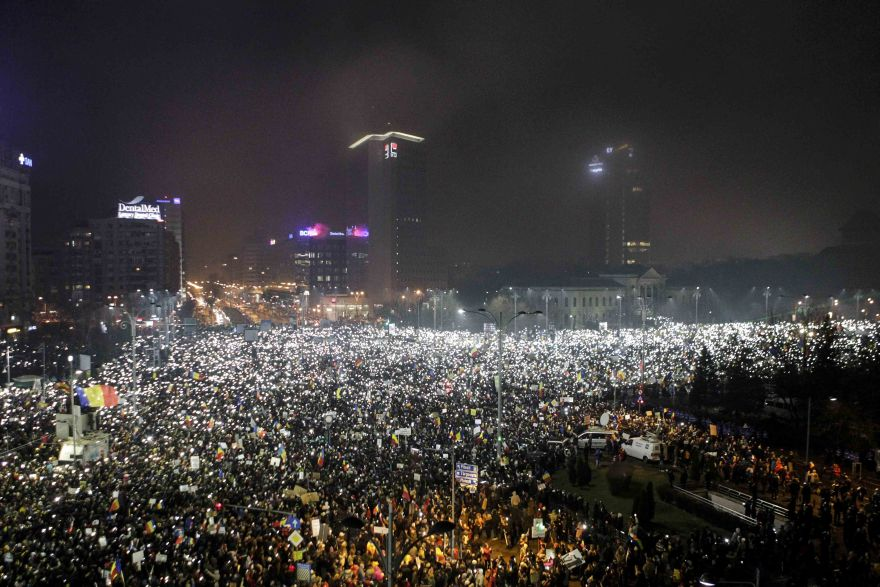 Protesters use phones and flashlights during a protest in Victoriei Square, in Bucharest, Romania, February 5, 2017. Inquam Photos/Adriana Neagoe/via REUTERS ATTENTION EDITORS - THIS IMAGE WAS PROVIDED BY A THIRD PARTY. EDITORIAL USE ONLY. ROMANIA OUT. NO COMMERCIAL OR EDITORIAL SALES IN ROMANIA. ROMANIA OUT. NO COMMERCIAL OR EDITORIAL SALES IN ROMANIA.