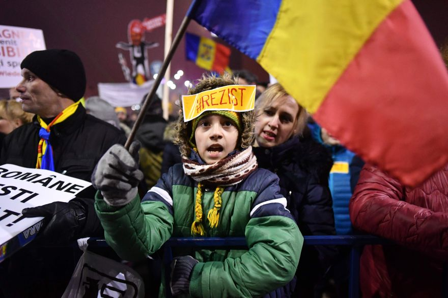 A teenager protests in front of the government headquarters against the government's contentious corruption decree in Bucharest, Romania on February 5, 2017. Romania's government formally repealed contentious corruption legislation that has sparked the biggest protests since the fall of dictator Nicolae Ceausescu in 1989, ministerial sources said. The emergency decree, announced on Tuesday (January 31, 2017), would have decriminalised certain corruption offences, raising concerns in Romania and outside that the government was easing up on fighting graft. Centre-right President Klaus Iohannis, elected in 2014 on an anti-graft platform, previously had called the decree
