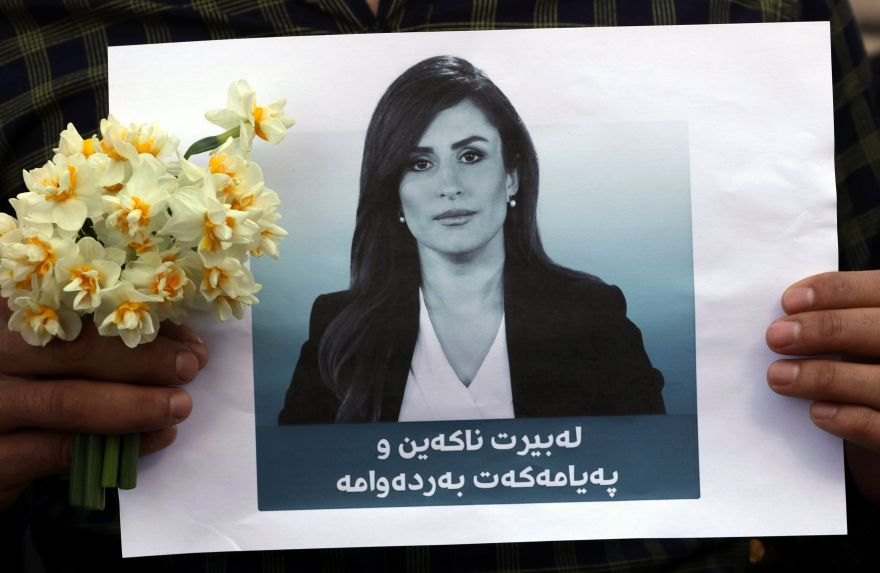 Students of Arbil's College of Journalism hold a portrait of Shifa Gardi, an Iraqi female journalist for Kurdish network Rudaw who was killed while covering the Mosul offensive, during a memorial ceremony on February 26, 2017, in the capital of the Kurdish autonomous region in northern Iraq. / AFP / SAFIN HAMED