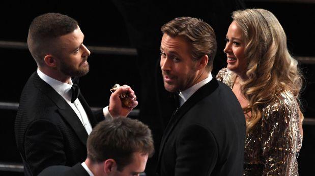 De izquierda a derecha, Justin Timberlake, Ryan Gosling y la hermana de este. (Foto: AFP)