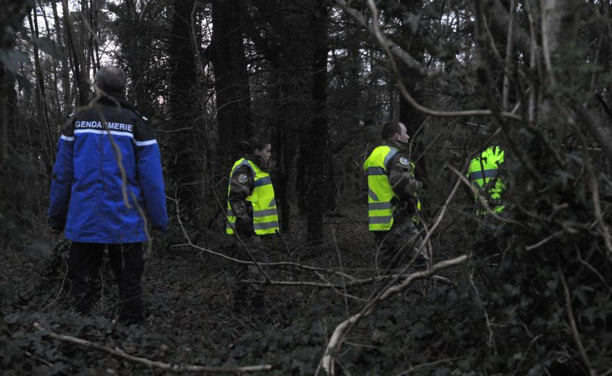 French gendarmes search near the site where a healthcare card in the name of a missing person was discovered by a runner on March 1, 2017, in Dirinon, some 20 km east of Brest, western of France. A jogger on March 1 found a pair of trousers with the national health card of a member of a missing French family in a pocket, a source close to the probe said. The items belonging to Charlotte Troadec, 18, were found early on March 1 in a town some 280 kilometres (175 miles) northwest of the family home in Orvault, a suburb of the western city of Nantes, the source said. / AFP / FRED TANNEAU