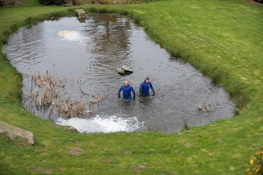 Gendarmes search in a pond ss part of the research for the Troadec family, missing since February 16, on  March 2, 2017 near Dirinon, western France.  The Troadec family -- Pascal and Brigitte, both aged 49, their son Sebastien, 21, and his sister Charlotte, 18 -- have not been seen since February 16. The mystery gripping intensified on March 1 as a jogger discovered items belonging to Charlotte Troadec a three-hour drive from where she was last seen. / AFP / FRED TANNEAU