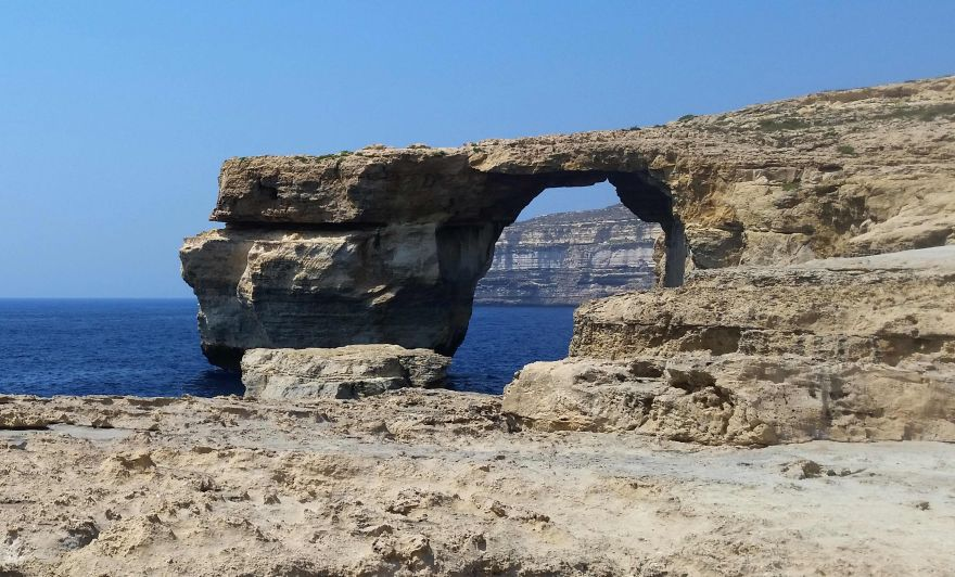 A picture taken on July 21, 2015 in Malta shows the Azure Window, a limestone arch on Gozo island. Gale force winds and high waves have destroyed the iconic Azure Window on the island of Gozo, Malta?s sister island. The Azure Window has represented Gozo and the island?s enduring raw beauty for many years and is believed to have formed about in the mid 19th century. The massive arch landmark with its flat top over the sea at Dwejra, endured raging seas but the storms that hit Malta and Gozo in the last couple of days swept the entire structure away at 9.40am on Wednesday. No one was injured.   / AFP / Am?lie BOTTOLIER-DEPOIS