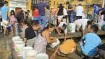 Recogen agua de pileta ubicada al lado de Palacio de Gobierno - Noticias de juan borja