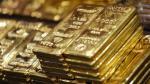 Oro baja por avance del dólar y acciones - Noticias de precio del oro