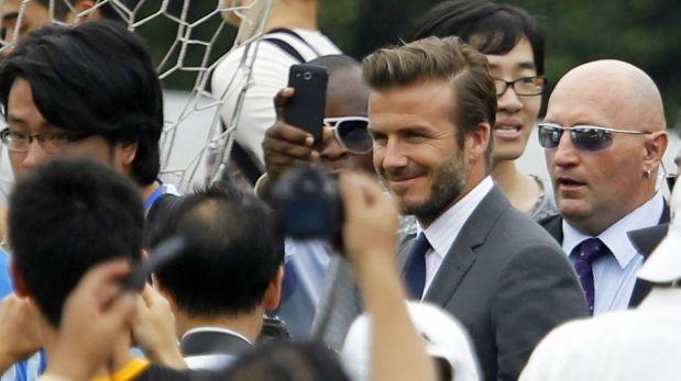 FOTOS: visita de David Beckham genera locura y una estampida humana con heridos en Shanghái